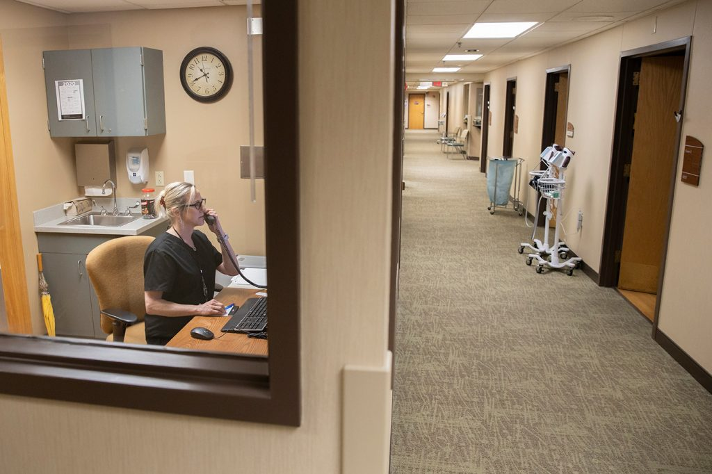 Joni See, a registered nurse with the Student Health Center answers patient calls.