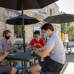 Students play cards outside of the Student Center Aug. 19, 2020. Sam O'Keefe/University of Missouri