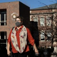 Pam Roe, adjunct instructor for J1200, walks from the School of Journalism.