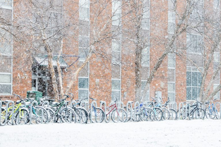 January snow covers bikes parked on the Mizzou campus.
