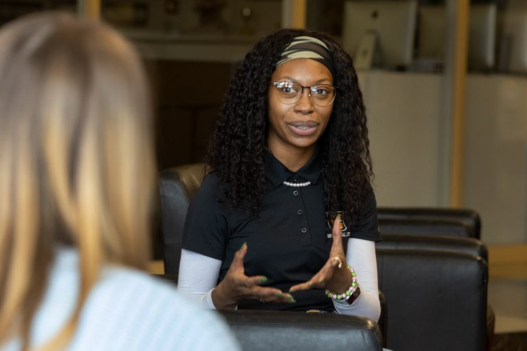 Makayla Adams, a hall coordinator with Residential Life, talks with a student inside the Student Center Feb. 11, 2021. Sam O'Keefe/University of Missouri