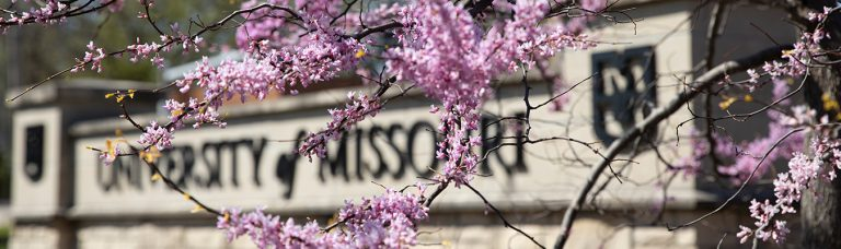 Spring flowers and blooming trees by the University of Missouri sign at Providence Road April 10, 2020. Sam O'Keefe/University of Missouri