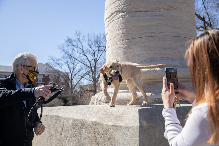 Dr. William Stackman and his 3-month-old dog Mac at the David R. Francis Quadrangle