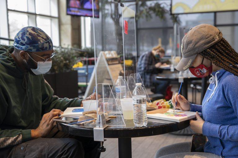 AnaBeth Spivey, a Health Sciences major from Kansas City, and Joseph Brown, a Black Studies major from Kansas City, participate in the Trap 'N Paint event in the Student Center at The Shack March 16, 2021