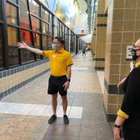 Derrek Hardy points out the cardio area while giving a tour of MizzouRec
