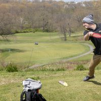 Quentin Borengasser, member of the Mizzou Disc Golf Club, plays the new course at AL Gustin