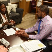 2020 Emerging Leaders intern Nia Neville, left, works with former state Rep. Tommie Pierson, Jr. (D-St. Louis) on revisions to a legislative bill at the state capitol in Jefferson City in March 2020.