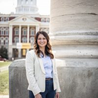 Picutre of Kenna Cornelius standing in front of Jesse Hall