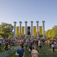 Picture of students running through the Columns during Tiger Walk